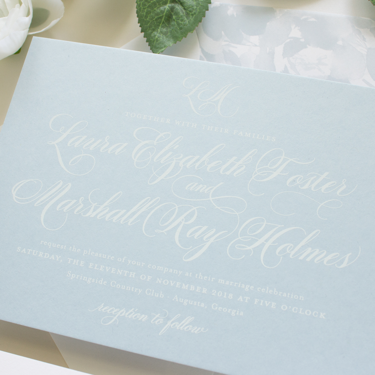 white and dusty blue invitations