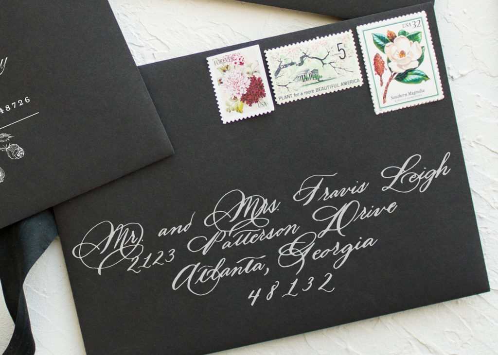 white calligraphy on black envelopes