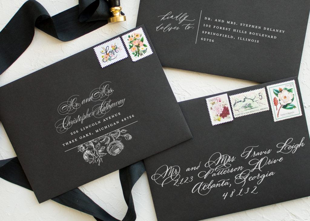 white ink printing on black envelopes