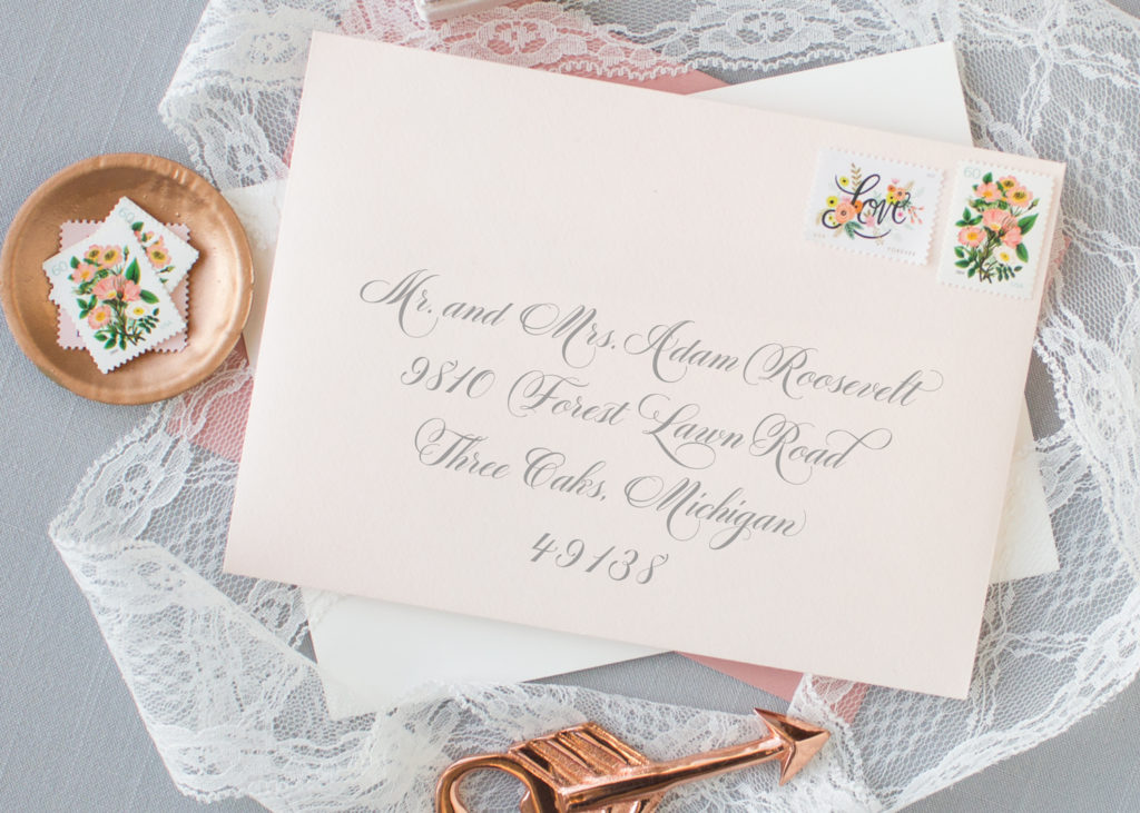 blush envelope with calligraphy script