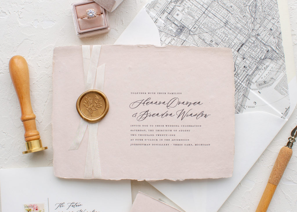 wedding invitations with wax seals and silk ribbon