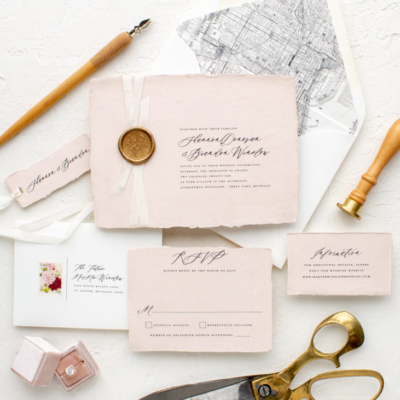 Wax seal invitation on hand made paper