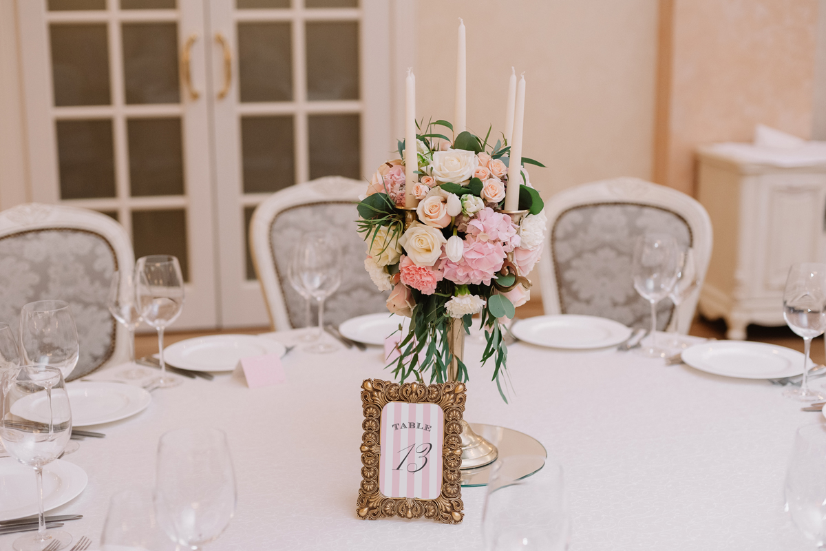 wedding reception table numbers with pink stripes