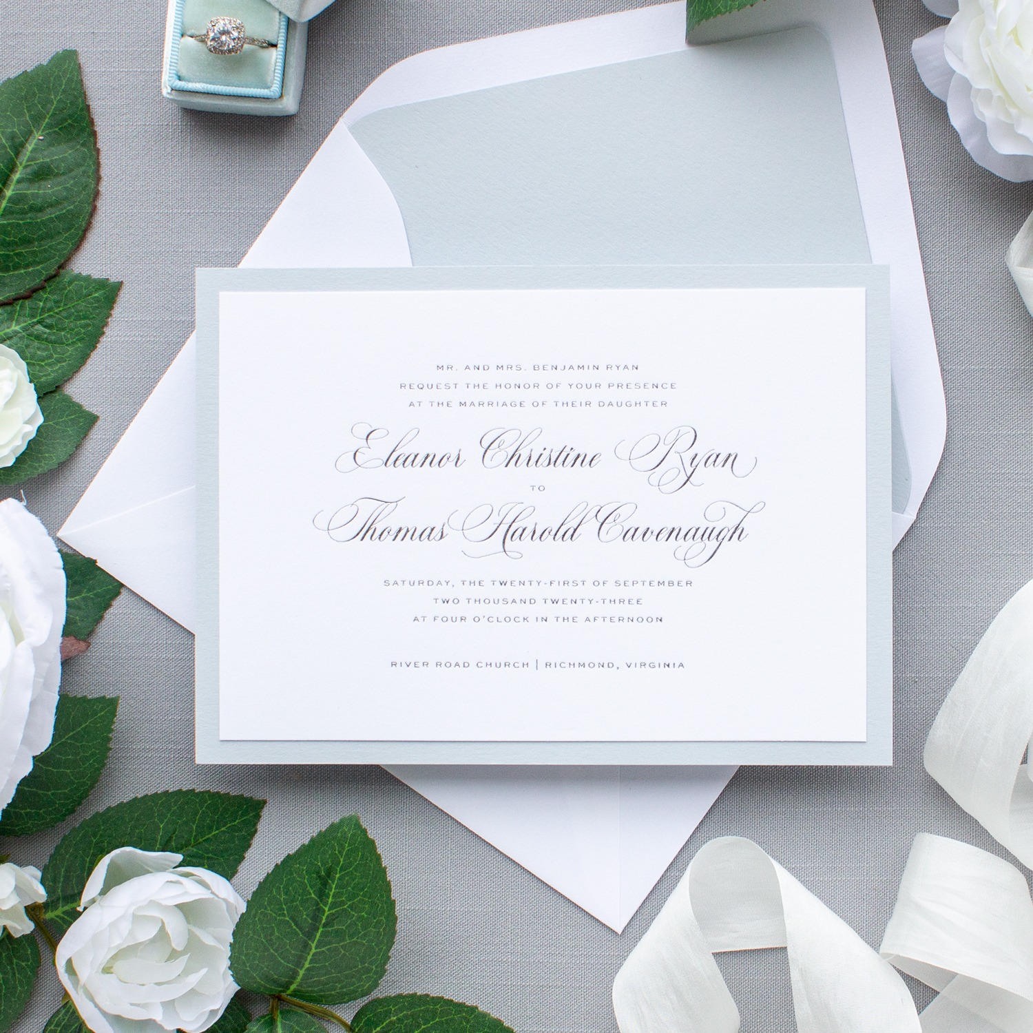 foil pressed wedding invitation in silver