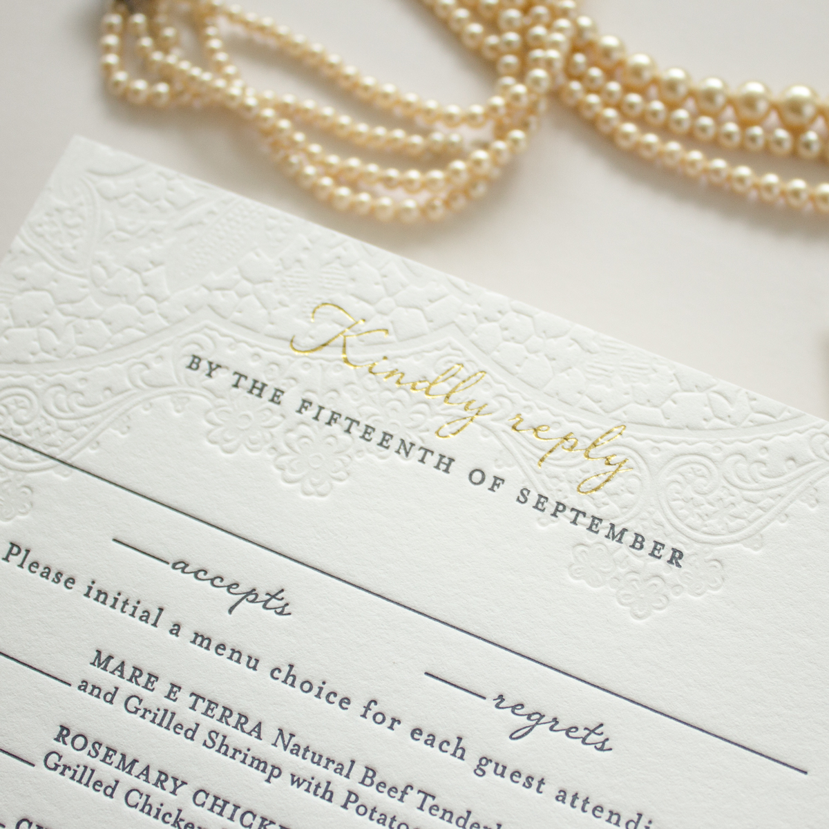 gold foil and blind letterpress reply card