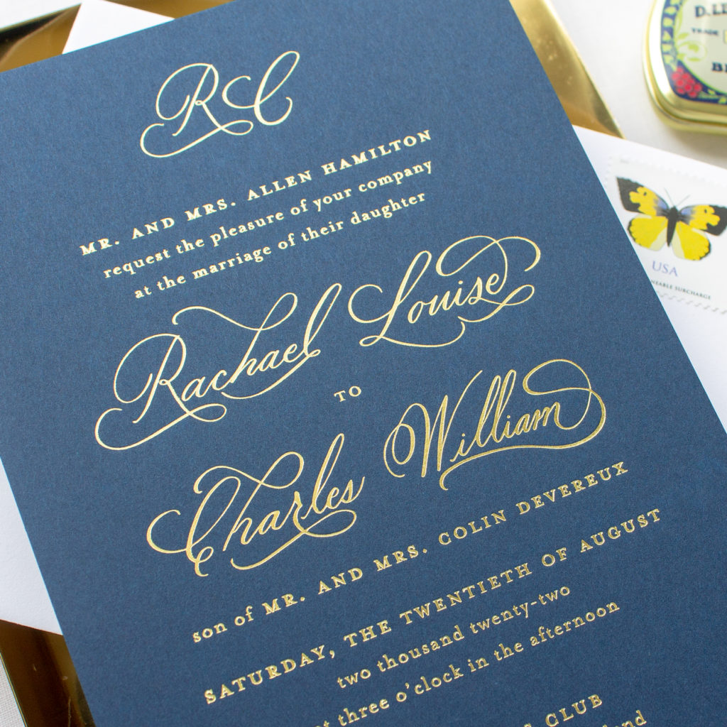 calligraphy wedding invitations in navy and gold