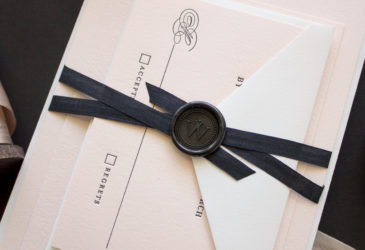silk ribbon and topped with a monogram wax seal