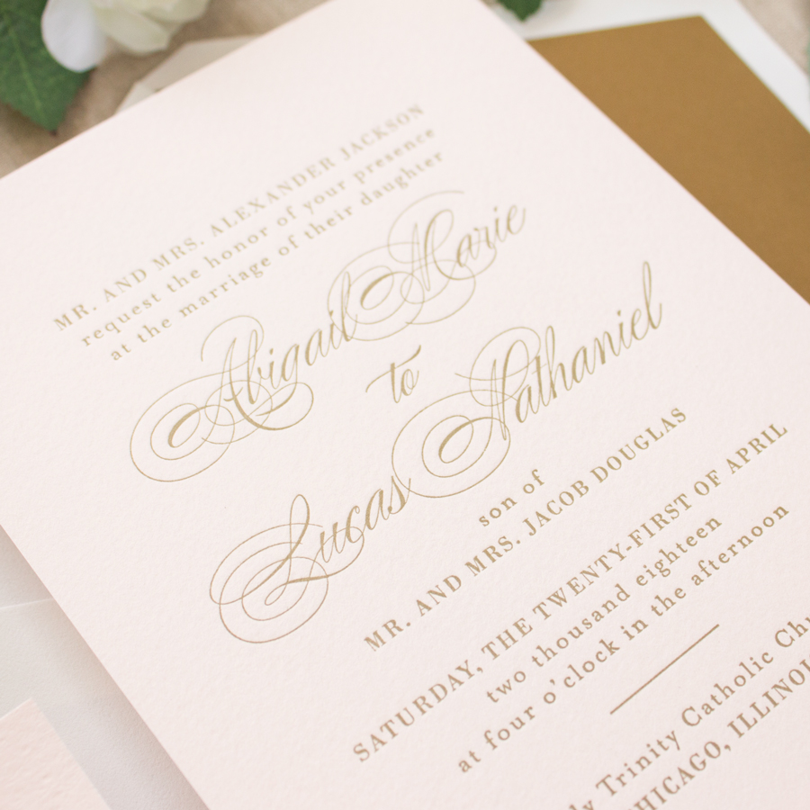 gold letterpress on pink paper