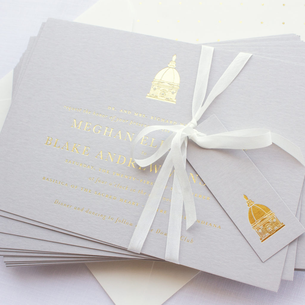 wedding invitation with gold foil on gray paper