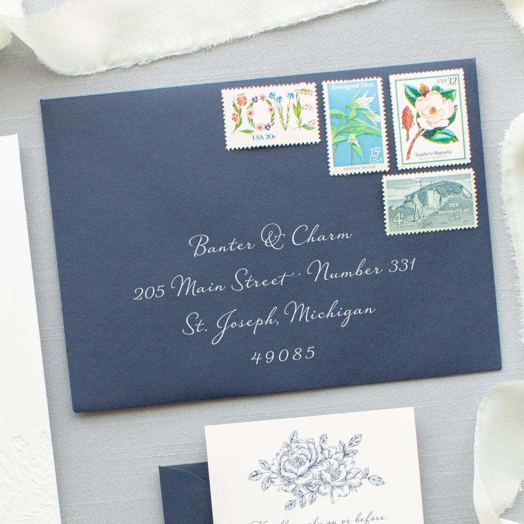 white ink on navy blue envelopes