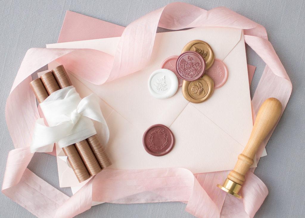 blush pink envelope with wax seals